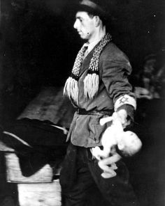 Warsaw, Poland, A burial society worker holding a dead baby.
