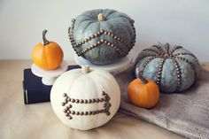 Nailhead trim's not just for headboards! Regular nails, thumbtacks, and even sewing pins work, too, for this no-carve pumpkin decoration.