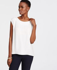 Go straight to the top with this wear-with-all shell, confidently cast in the season's prettiest palette. Jewel neck. Cap sleeves. Back pleat.