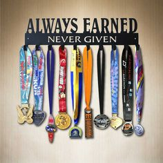 Always Earned Never Given Medal Display for sports. Want to put in a teen girl's softball room. by SportHooks