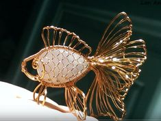 One of the most innovative wire jewelry designers is Lan Anh who is from Vietnam. I have seen many wire caged cabochon designs but her g. Wire Wrapped Jewelry, Beaded Jewelry, Stone Jewelry, Gold Jewelry, Jewellery, Chicken Wire Art, Wire Art Sculpture, Wire Jewelry Designs, Jewelry Making Tutorials