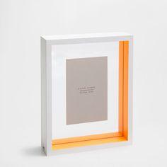 Orange and white glass frame