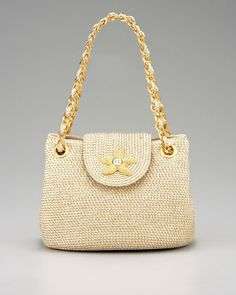 Love that little starfish. Love the magenta version of this bag. I got a Javits bag this year, and I'm crazy about it. Could turn into a collection...! Mini Star Shoulder Bag by Eric Javits $300 @ Neiman Marcus.