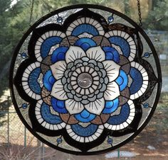 I designed this one of a kind stained glass mandala panel constructed from Youghiogheny and Spectrum glass. This panel measures 18.5 in