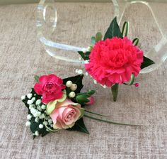Buttonhole and corsage to compliment the cerise colour in their outfits