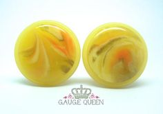 """Yellow Swirl Lucite Plugs - 0g (8mm) through 1"""" (25mm) – Gauge Queen Genuine vintage 1980s lucite plugs. They have a swirled design with depth, done mainly in yellow and peach with white and some areas of gold. The colouring is random and no two are the same. These are big plugs, the domed rounds measure 30mm, 1"""" (25mm) pictured."""