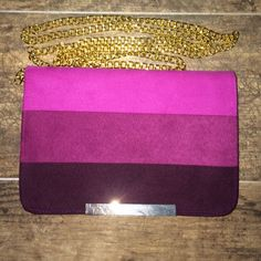 Purple chain bag Three shades of purple strip chained bag. There are no pockets. Bought at a boutique. NWOT Bags