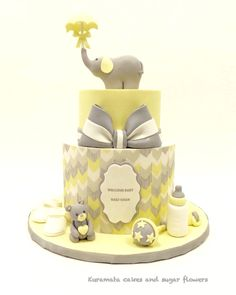 Elegant yellow and gray baby shower cake !