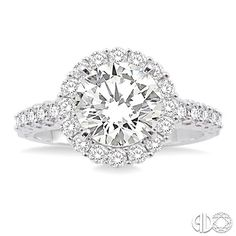 Classic round brilliant cut diamond engagement ring with halo setting.
