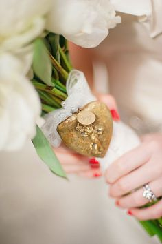 tie a vintage locket on your bouquet... I love this idea!