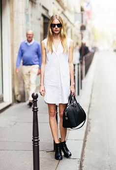 White sleeveless shirt dress worn with black ankle boots