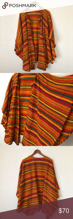 Vintage 1960's Mexican woven poncho Beautiful late 60's Mexican poncho. Hand-loomed woven wool fabric, drapey fit. Lovely earthy warm colors. One size fits all. Excellent condition! vintage Tops Tunics