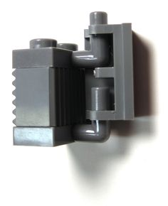 https://flic.kr/p/7choEm | Another Hinge Idea | The hinge brick is quite loose and moveable with this set up, though it does not fall off. It does slide up and down easily to a small degree. The top plate with arm up has to be slid in at an angle, but it does not take much pressure to do so. I think it's better than attempting to push it directly into the clip on the hing brick as it creates little stress.
