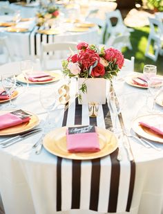 striped table runner - photo by Ben Q Photography http://ruffledblog.com/whimsical-garden-wedding-in-dallas