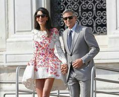 Amal Alamuddin. George Clooney. Wedding. Giambattista Valli Couture. White dress with floral details. Grey suit.