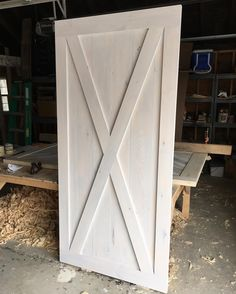 this xbrace barn door is ready for its new home we love the whitewash finish with a touch of classic gray stain mixed in