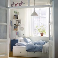 Hemnes pull out bed - IKEA - also like the display boxes on the wall