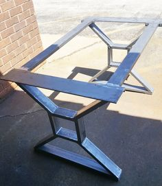 Modern, Dining Table X Legs with 2 Braces, Solid Table Base from 3 x 1 Tubing, 1/4 x 5 Mounting flat on top and 2 Cross Braces Load up to 1000 lbs. per leg This listing is for set of 2 Steel Tubing X Legs with 2 Braces - Made from Steel Tubing - 3 x 1 x 14 ga wall and 1/4 x 5 Flat bar on top - Legs are predrilled. - Finish - Raw steel, Clear coated, Black flat.