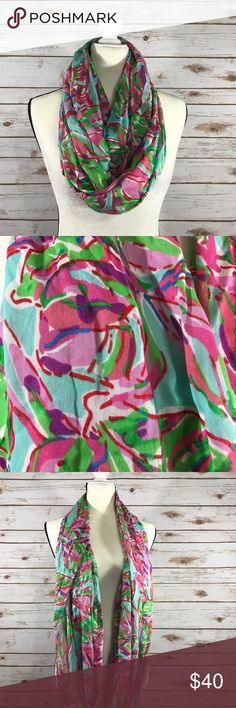 Lilly Pulitzer Infinity Scarf This is an infinity/ one size scarf from Lilly Pulitzer. This scarf is turquoise  with pink, green, red and blue designs. Please let me know if you have any questions. Please note in the last photo the small snag- unable to see minor imperfection when wearing. Thanks! Lilly Pulitzer Accessories Scarves & Wraps