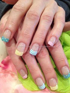 Multi coloured pastel tips with white stripe and polka dot nail art