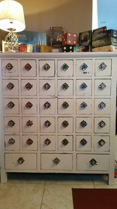 I turned an old apothecary cabinet into MTG storage! A great way to keep those cards organized and handy!