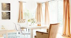 In the bright dining room of television host Louise Roe, grand head chairs upholstered in a plush velvet contrast beautifully with a simple Parsons table and acrylic side chairs. The look is at...