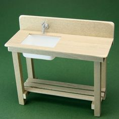 Make a miniature table, add backsplash and make a sink or potting bench.