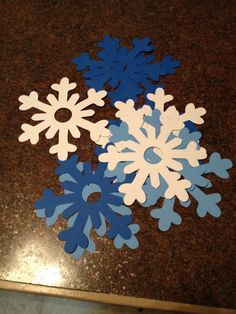"Disney Frozen Birthday Game - Musical Snowflake. Instead of musical chair, use snowflakes and play the song ""let it go""."