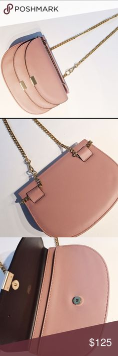 Faux Leather Chainlink Handbag Brand new faux leather bag with gold chain should strap. Interior fold over pocket. Interior zippered pocket. Strap is adjustable. Bags Crossbody Bags