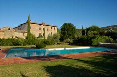 The swimming pool of La Fattoria del Rio di Sopra. Agriturismo in Umbria. Lago Trasimeno