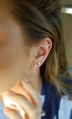My three lobe piercings and one helix. All white gold and diamonds. More to come! #piercings #helix #diamonds #diamondearrings