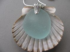 Seafoam Seaglass Pendant, Necklace Jewelry Beach Glass Jewelry Beach Glass Pendant by sourisbytheseaglass on etsy Perfect sea glass makes this beautiful pendant. The sterling silver pinch bail attaches to the well rounded sea foam sea glass. The pendant has an 18 inch sterling silver chain. This genuine sea glass comes from a beach on the east coast. It is surf tumbled, smooth and one of a kind. The sea glass is compared to a quarter and ruler measurement in the photos. See my ENTIRE…