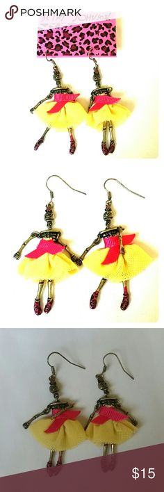 "Betsey Johnson Skelton Dancing Ballerina Earrings New with original holding card Betsey Johnson bronze dancing ballerina skeleton earrings. They are wearing a yellow mesh dress with hot pink ribbon, head & limbs move independently, so they can dance! Small enameled pink rose on top of their heads, and rose red pink ballet slippers. 2"" long.  Thank you for checking out my closet, and happy poshing!! :)   SORRY, NO TRADES OR OFF SITE SALES.   I DISCOUNT ON BUNDLES :) Betsey Johnson  Jewelry…"