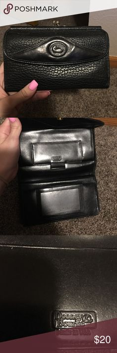 Vintage Dooney and Bourke wallet black Vintage Dooney and Bourke wallet black in good condition some marks in the coin area as shown in pictures Dooney & Bourke Bags Clutches & Wristlets