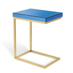 The Vivienne C Table is an ultra-useful workspace or end table because you can pull it up to a sofa a chair, or position over a chair's arm - anywhere and any time you need a useful slice of tabletop. An ideal working height, this C-shaped table's spacious surface can hold your laptop, dinner plate and wine; you get the idea. We know you'll use it a lot, so we created it as an elegant, stylized piece you'll love living with. In a polished-gold finish over beautifu...