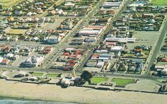 Aerial View of New Brighton, the old wooden pier was gone then. That should help narrow down that date a wee bit. The Ryan bros demolished the old pier in 1965 (in one day apparently). and before the shoreline burnt down. 1970's. New Brighton, Christchurch, New Zealand