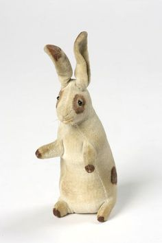 Toy rabbit called Tiny, in an upright stance, printed cream velvet with brown spots; English, ca.1902