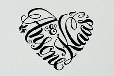Monogram created using bride and groom's names in a heart-shaped design. Seven Swans Wedding Stationery