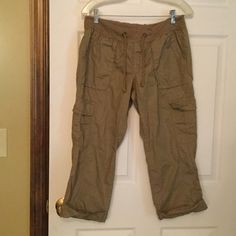 Old Navy Capri's Stretch at waist with drawstring.  2 pockets in front, side and back.  With cuff at bottom of pants.  100% cotton, made in India.  Light weight.  Light brown, tan color. Old Navy Pants Capris
