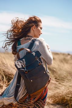 """Unisex handmade Backpack in gray water-resistant canvas with chestnut brown leather accents.  Fits up to a 17"""" laptop, books, and essentials!  Great for school or work.  - Jenny N. Design (www.jennyndesign.com)"""