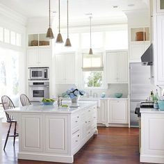 Beautiful and timeless, white cabinets are a versatile choice for any kitchen. One attraction of white cabinetry is that it works with multiple architectural styles -- from traditional to country chic to contemporary! http://www.bhg.com/kitchen/remodeling/planning/trends/?socsrc=bhgpin010515whitecabinetry&page=2