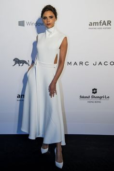 Pin for Later: How Victoria Beckham Went From Spice Girl to Style Icon Victoria Beckham Style Evolution Making a statement in a sleek white ensemble for the 2015 amfAR Hong Kong Gala in March.