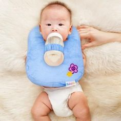Lazy Parent Baby Bottle Holder - http://www.gadgets-magazine.com/lazy-parent-baby-bottle-holder/