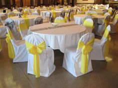 Wedding Chair Covers $1.  White Covers, Yellow and Silver Sashes. Bellingham WA