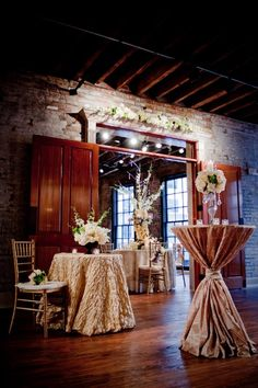 love the exposed brick and doors