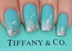turquoise nails with glitter on the tips