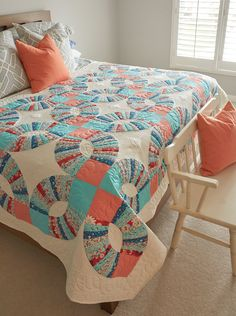 Looking for big block quilt patterns? You've come to the right place! Folk Dance, by Diane Tomlinson, is a great example of an antique design that looks modern. With contemporary prints and colors in a big, big block, this bed-size quilt fits into any home today.