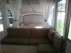 My own pop-up camper re-do.  Covered cushions with microfiber, changed privacy curtains, etc.