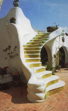 adobe house ~ wow, that's what I call stairs to... Love the yellow tiles too. Amazing roof top for....