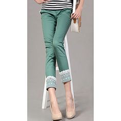 Skinny Style Pants, with beautiful lace trimmings at waist and ends of pants, Fabric is made of cotton.